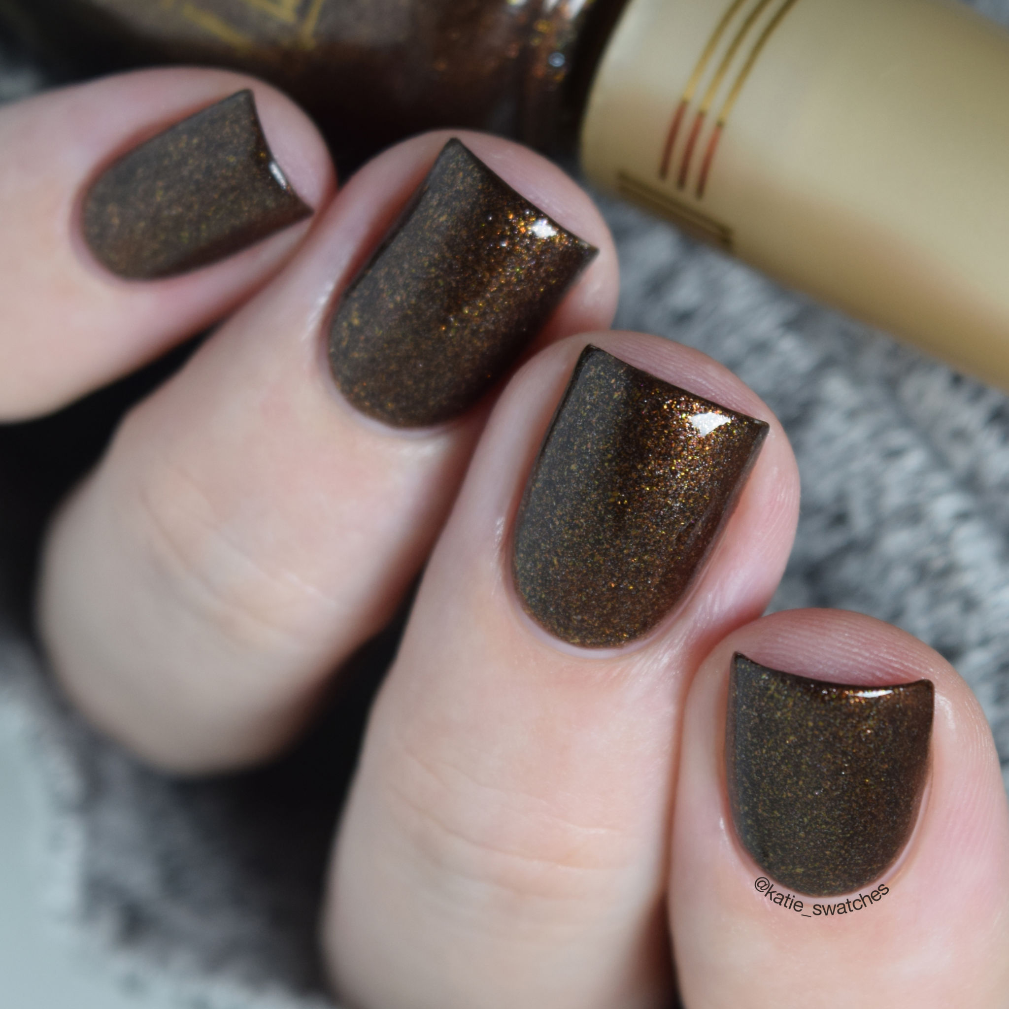 Milani Chocolate Sprinkles brown holographic nail polish swatch