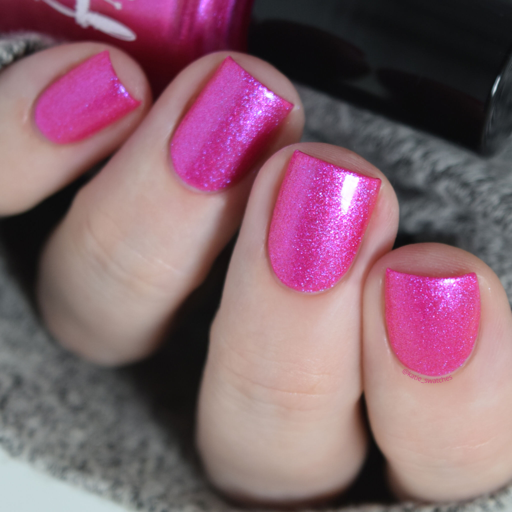 Girly Bits - Electric Boobs nail polish swatch. Fuchsia pink matte nail polish with a pink/purple shimmer.