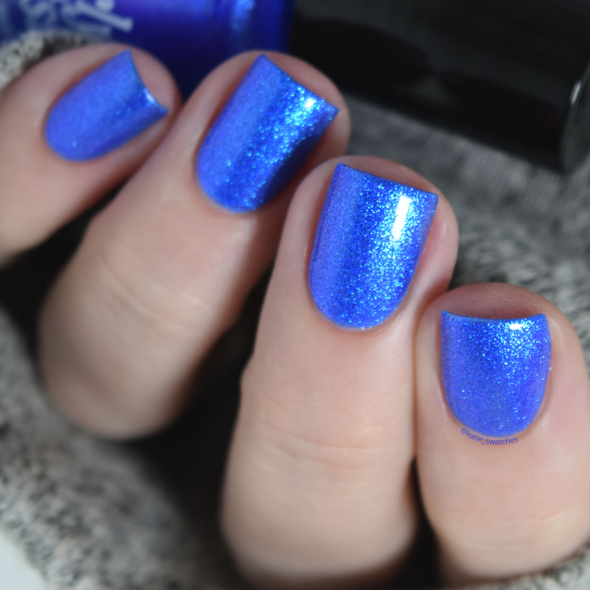 Girly Bits - Hot Dogs nail polish swatch with top coat. Ultramarine blue matte nail polish with a violet/blue shimmer.