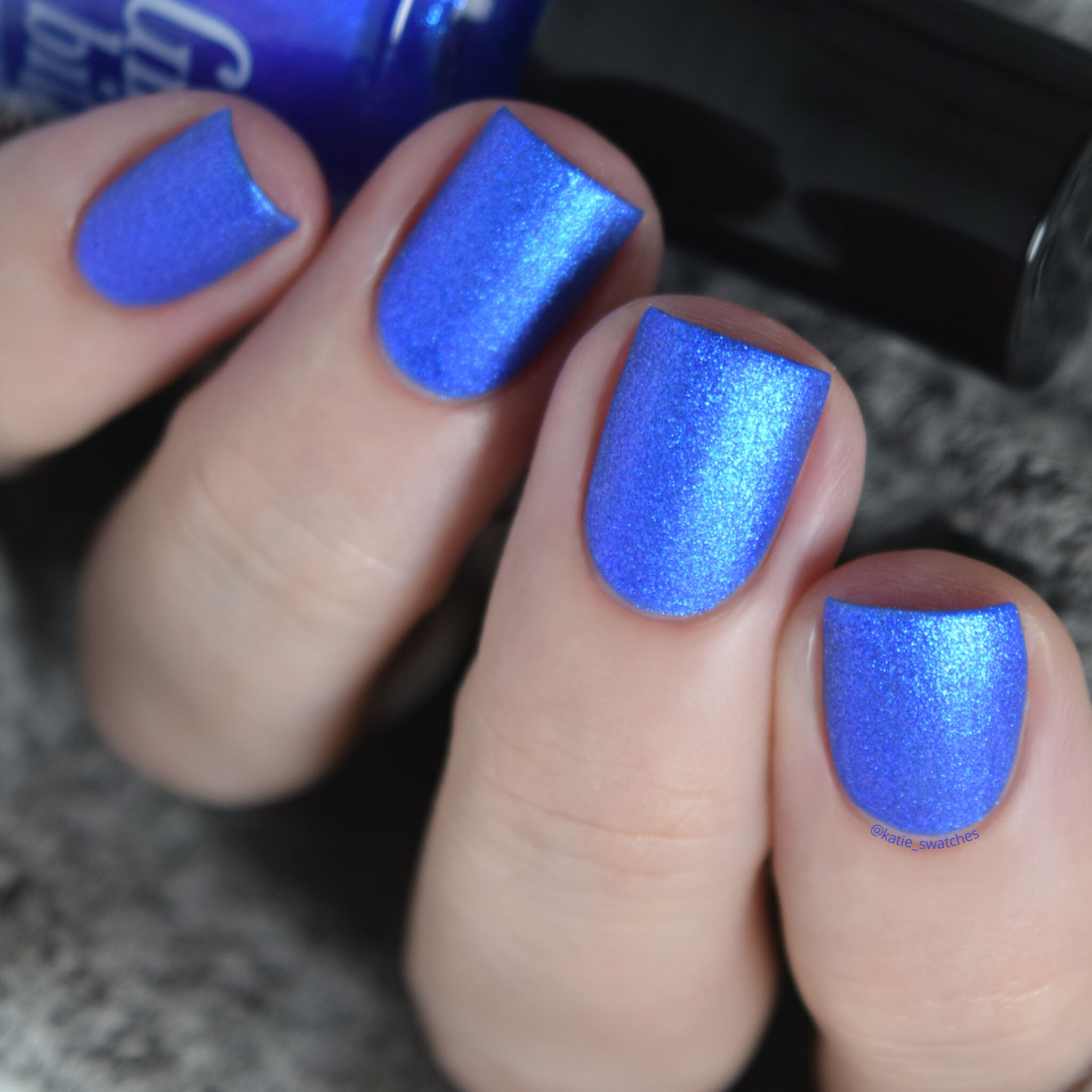 Girly Bits - Hot Dogs nail polish swatch. Ultramarine blue matte nail polish with a violet/blue shimmer.