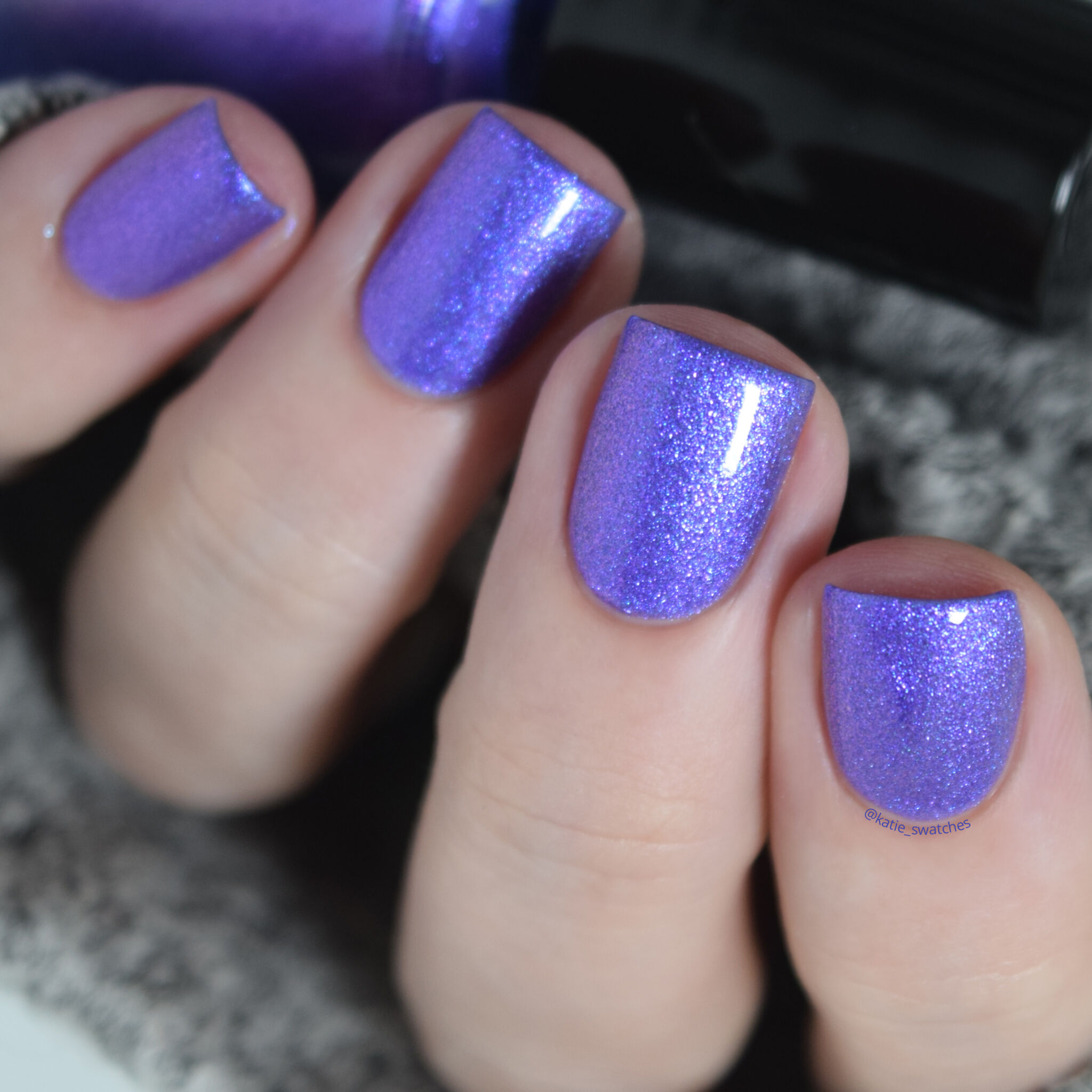 Girly Bits - Kiss This Guy matte nail polish swatch with top coat. Medium purple nail polish with a pink shimmer.