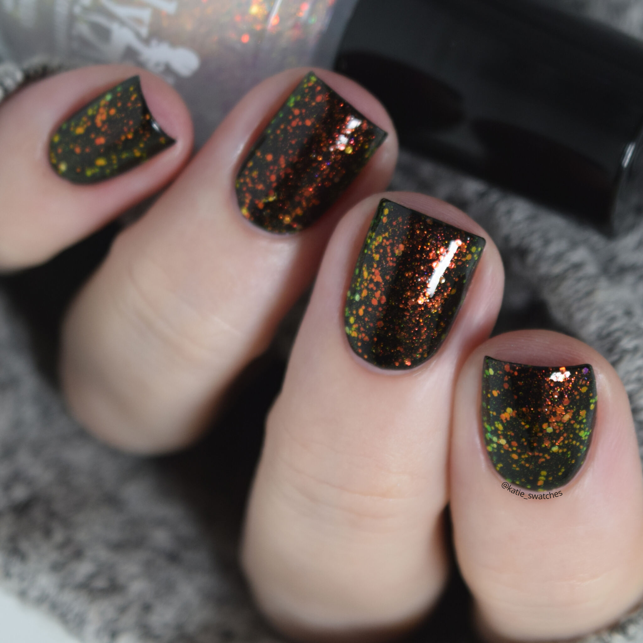 Girly Bits - Tony Danza iridescent colour shifting glitter nail polish topper layered over Girly Bits Little Black Dress (black creme nail polish)