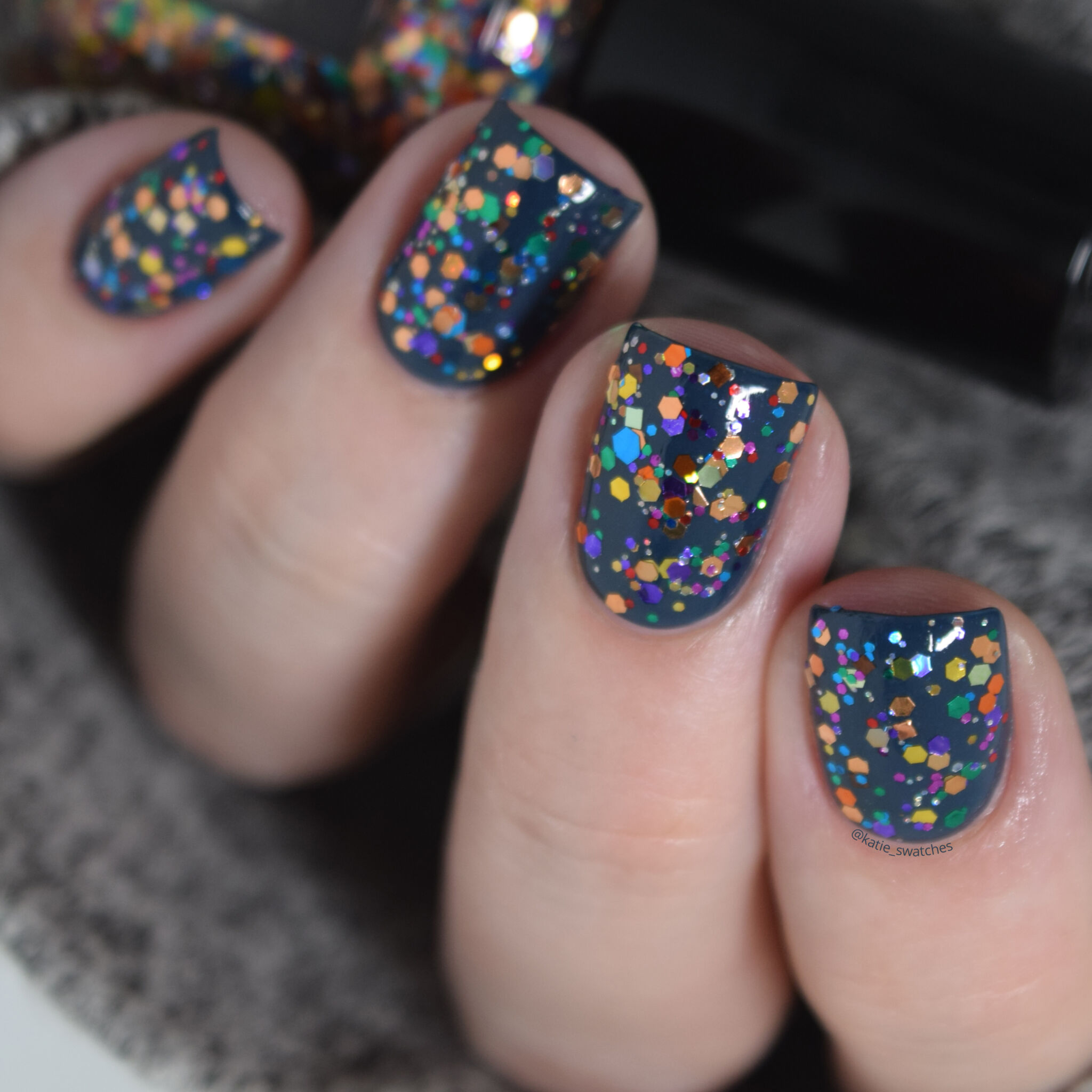 CrowsToes Nail Color Thing colorful glitter topper nail polish swatch indie nail polish layered over Catrice Hip Queens Wear Blue Jeans blue creme nail polish