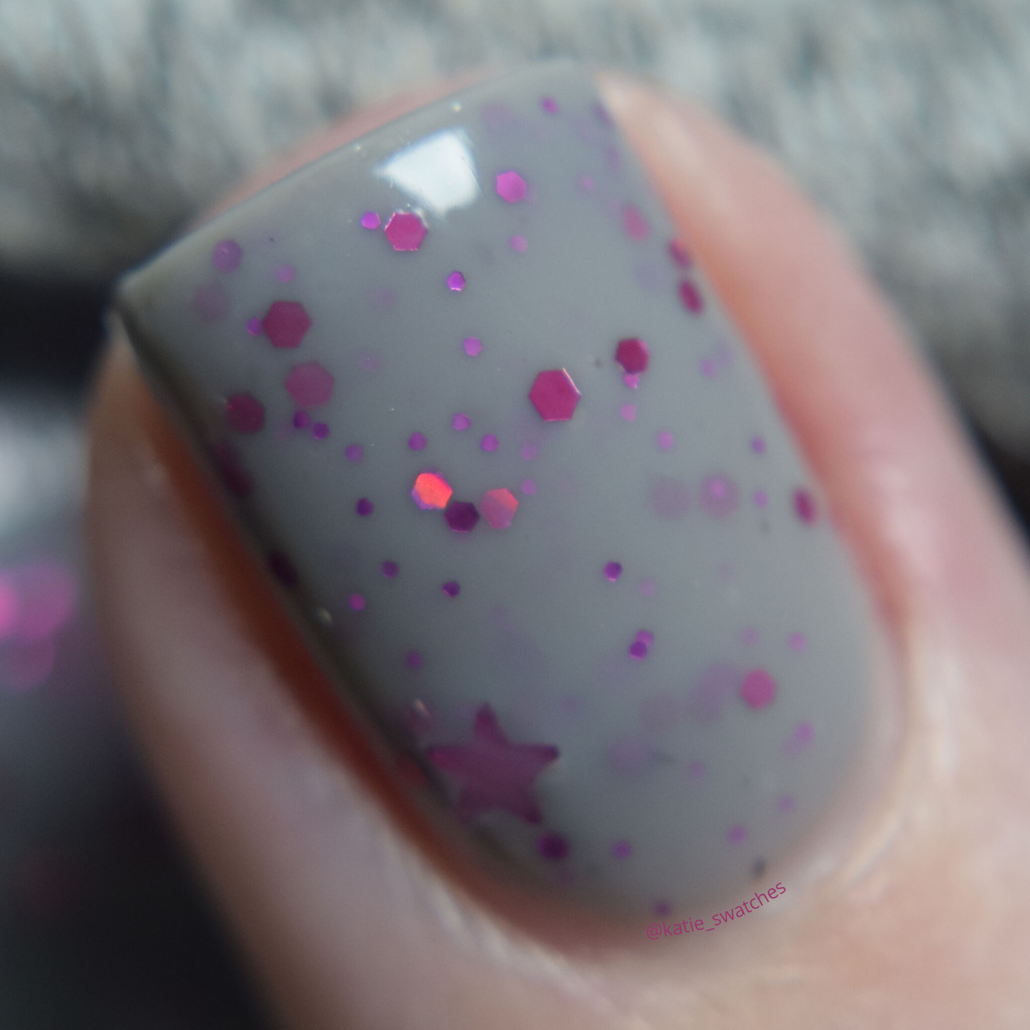 My Indie Polish - In The Beginning nail polish swatch macro Polish Pickup PPU March 2020. Grey crelly nail polish with metallic pink glitters