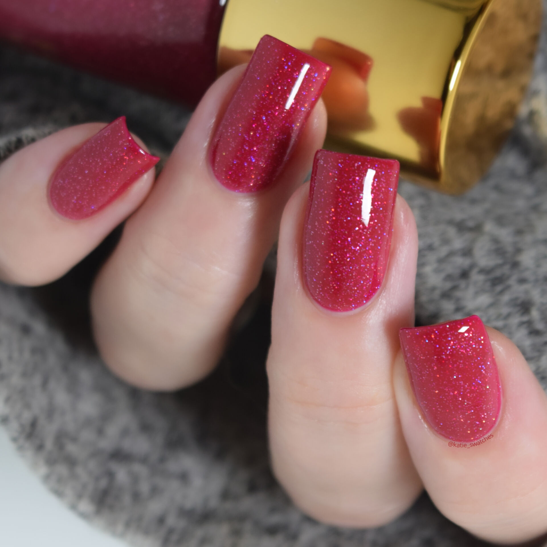 Tripe O Polish - Ooni raspberry jelly nail polish with holographic glitter swatch