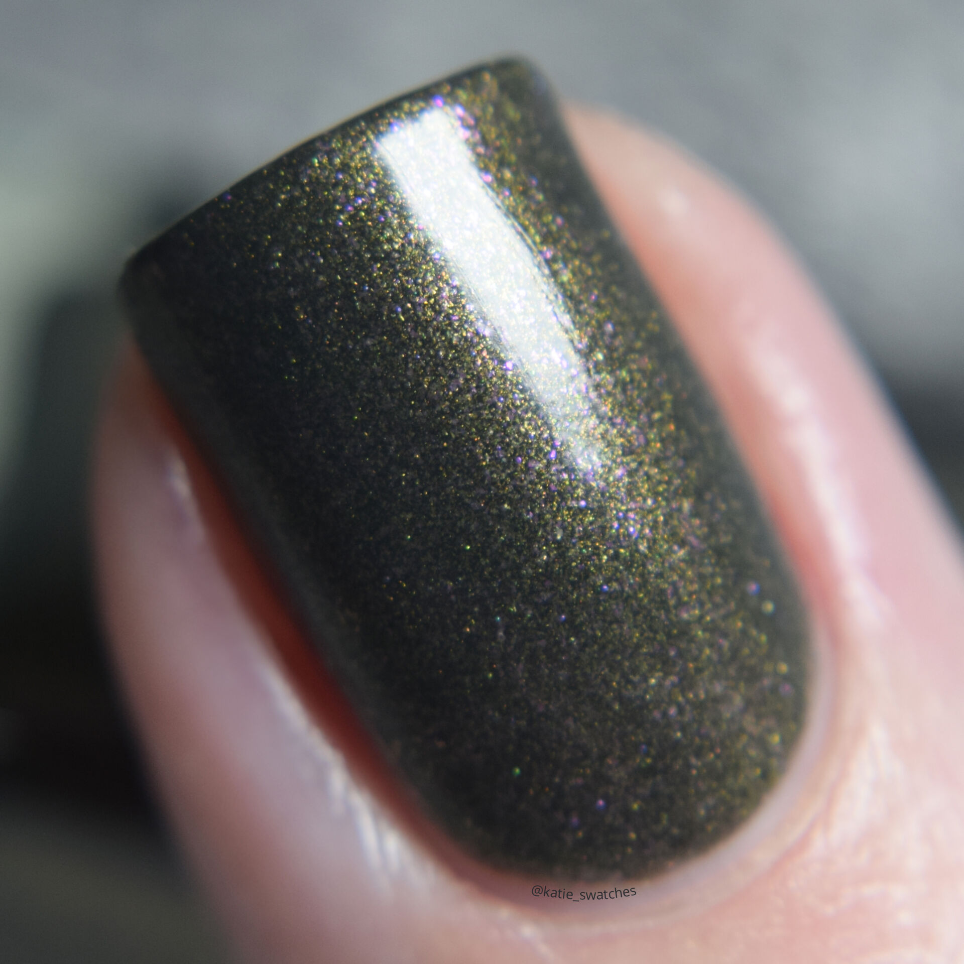 Rescue Beauty Lounge RBL Anne olive green nail polish with gold/pink shimmer. nail polish swatch macro